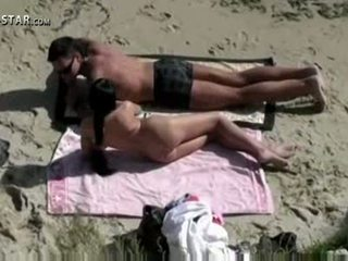 Another scene of the same couple on the beach