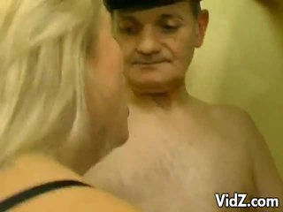 Blond whore in an orgy of papas