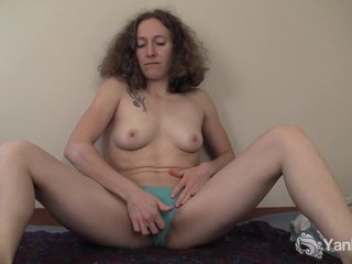 Curly Haired Nina Fingering Her Slick Quim