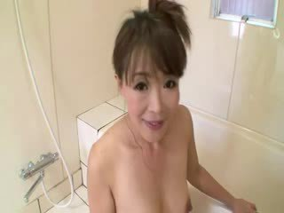 Asian mature in shower sucks on cock before stimulating herself