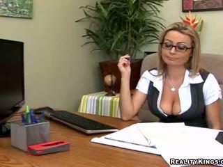 Alexis May looking luscious behind her big desk