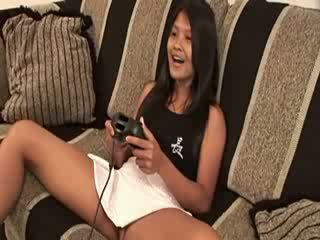 My Thai chick playing video game naked