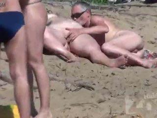 Nackt strand voyeur