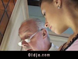 Brunette licks oldman all over his sere skin and fucks him