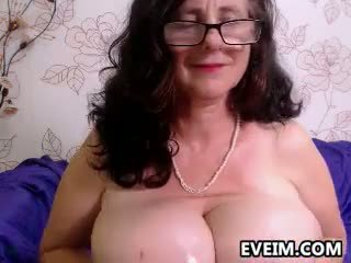 Granny Shows Off Her Big Breasts