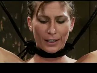 Brunette Girl Tied Up Tortured With Clips And Weight Pussy Stimulated With Vibrator By Master And Mistress In The Dungeon