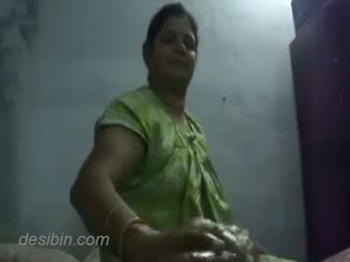 Indian aunty giving cock massage to hubby for