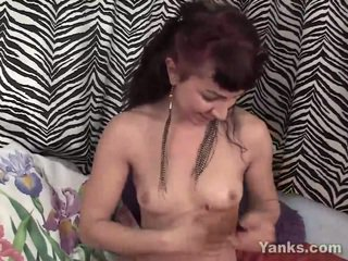 Rubbing lotion all over her slim body