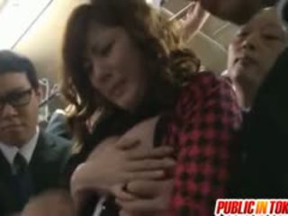 Yuma Asami Strokes Penises In Full Bus