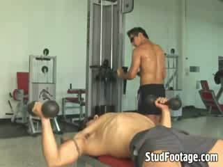 Two horny handsome guys fuck each other on the bench press in many positions