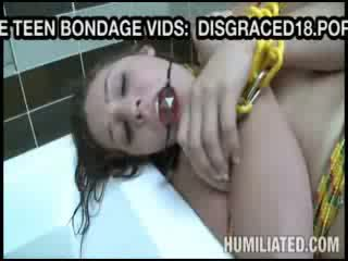 Bondage girl gets toy fucked before BJ