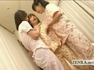 3 young Japanese girls kissing