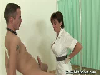 Mature nurse giving a hj