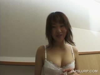 jap chick shows sexy Juggs in close-up