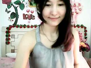 Cute Korean cam girl tempting with plump tits