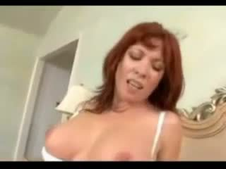 Busty redhead fucked in bed