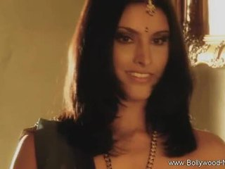 Bollywood beauty strips in teases