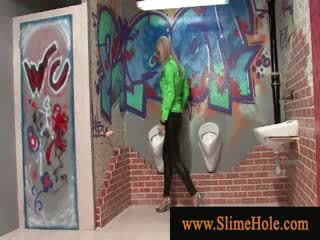Blondy loving slimy goo from toy cock at the gloryhole