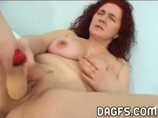Red-haired Dumb Mom Fucks Herself With A Fake Plastic Penis