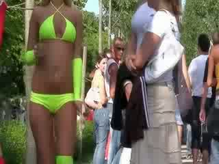 The sexy bikini doll is performing a Gorgeous funny dance for the pleasure of the public