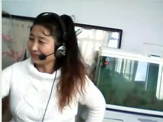 Chinese MILF shows breast and panties