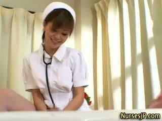 Horny asian nurse babe gets a cumshot