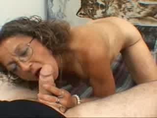 A grandma gives a blowjob