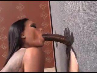 Raven Bay fucks a black dick through a wall