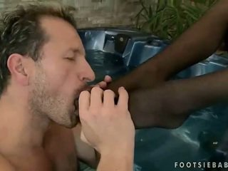 Sexy brunette gives footjob and gets fucked