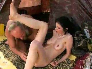 Two grandpas pissing on young slut