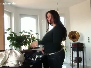Nadine at home playing with her boobs