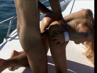 Blonde skank loves huge dick in all her holes as she fucks outside on a boat