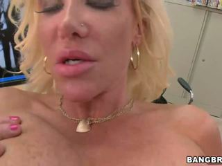Busty blonde MILF shows off her massive boobs