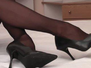 Sensual blonde with long legs in black pantyhose fools around