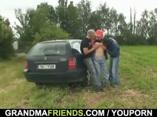 Two dudes pick up and screw old babe