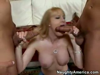 Blonde momma Bethany Sweet takes one cock at a time in her mouth like candy