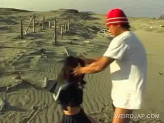 Asian school cutie forced to give blowjob in POV at the beach