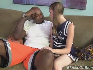 Pigtailed cheerleader enjoys facial