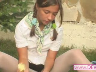 Girl masturbating with banana dildo