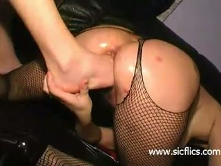 Nasty slut fisted and foot fucked in her huge cunt