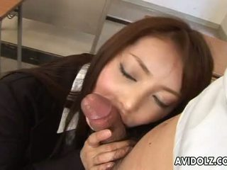 Brunette Asian is on the dick sucking it down