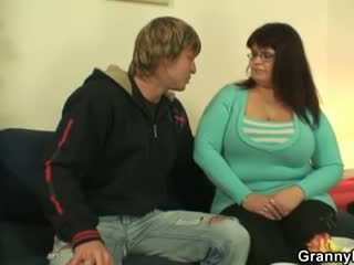 Busty fatty spreads her legs for a str...