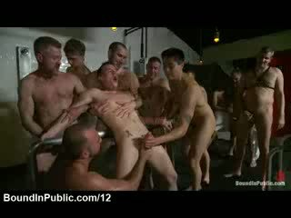 Bound gay cock jerked by strangers in bathhouse