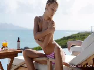 Beautiful blonde babe teasing on sunbed